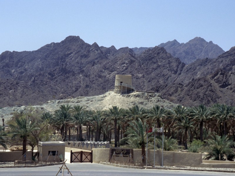 DXB Hatta Heritage Village - entrance gate with watchtower and Hajar mountains 5340x3400